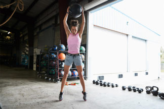 Woman Preparing to Slam Medicine Ball