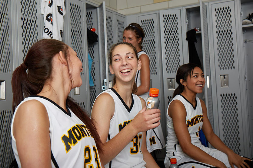 women basketball players in the locker room preparing for a basketball game