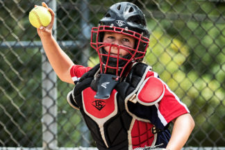 Softball Catcher Throwing Softball