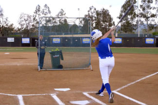 Softball Batter Practicing Two Plate Driill