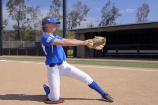 Softball Pitcher Practicing Arm Speed Knee Drill