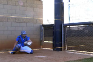 Softball Catcher Performing Rise and Drop String Drill