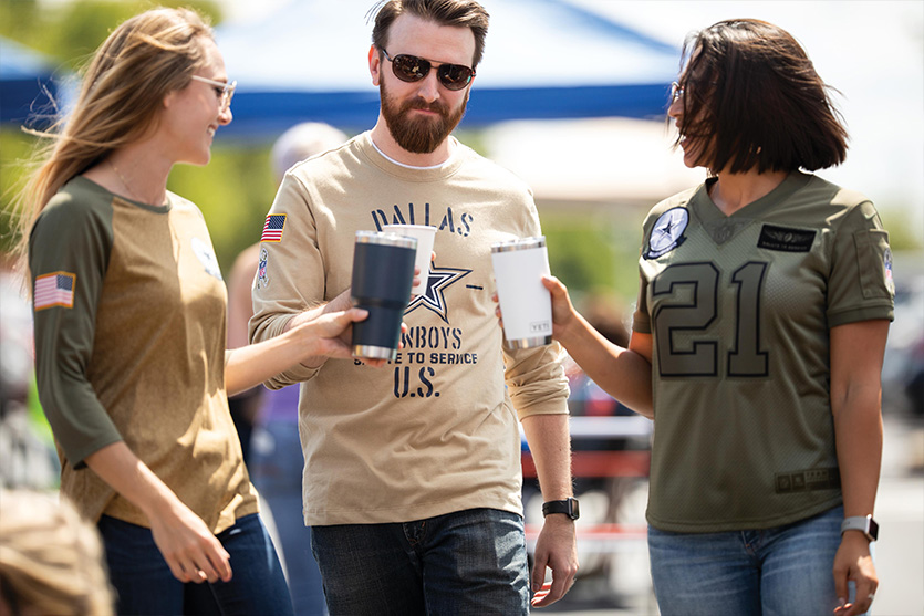 group of people at a tailgate wearing Salute the Troops jerseys