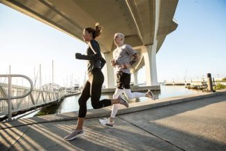A man and a woman go on a run.