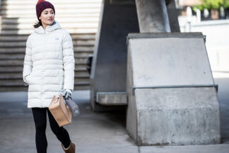 woman wearing the white The North Face Women's Gotham II Down Pa