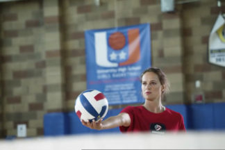Kelsey Robinson Holding A Volleyball