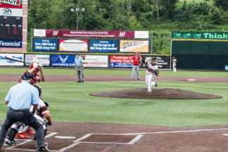 Baseball Pitcher Throwing Pitch During Baseball Game
