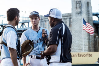 baseball coach talking to two of his players