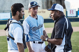 Baseball Coach Talking To Pitcher And Catcher