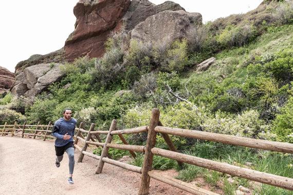 man running in nike running gear on a trail, trail running