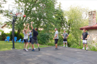 Basketball Players Playing Basketball In Thew Driveway