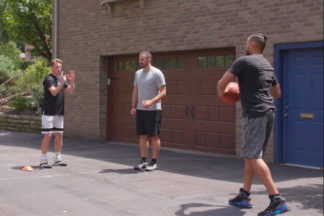 Basketball Players Playing Basketball In The Driveway
