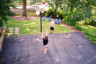 Basketball Players Shooting Hoops In The Driveway