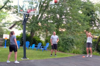 People Shooting Basketball In Driveway