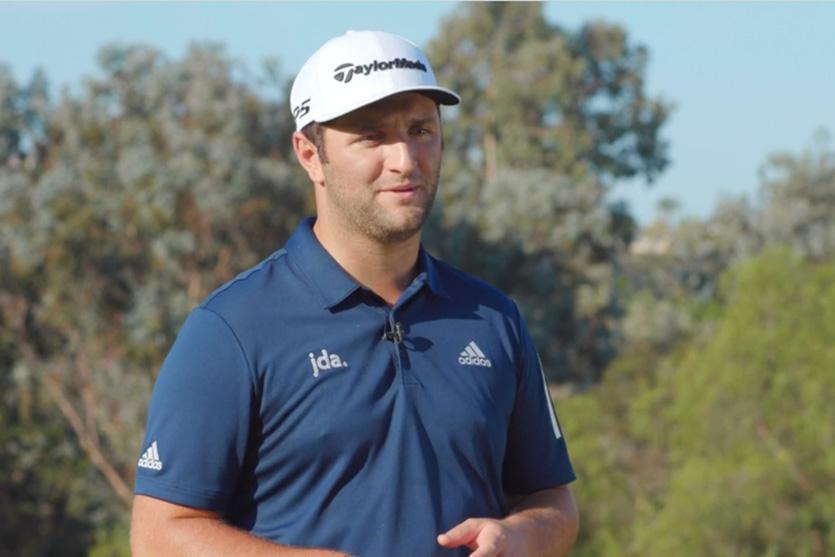 Jon Rahm wearing adidas golf shirt and taylormade hat