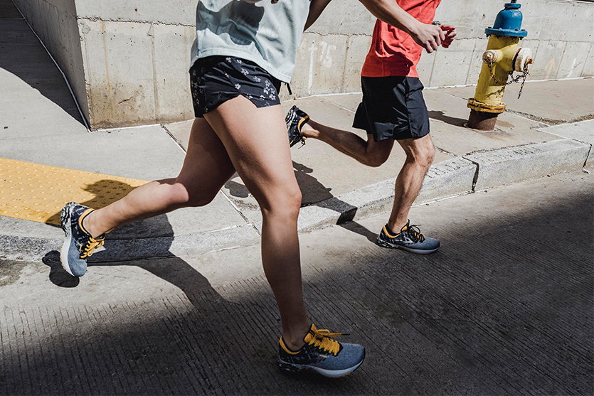 male and female runners with brooks running shoes
