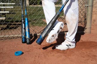 Louisville Slugger Prime BBCOR Bat 2020 in the batter's box