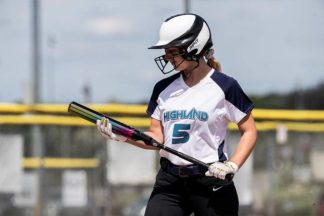 Softball player holding the DeMarini Prism softball bat