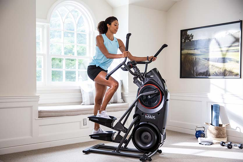 woman working out on a Bowflex M6 Max Trainer.