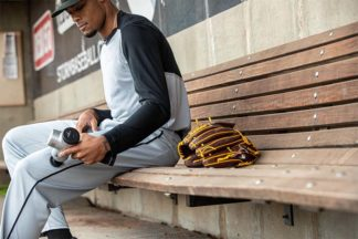 Baseball Player Using Hyperice Percussive Therapy Device