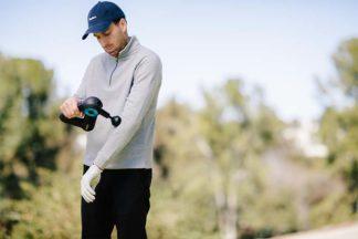 Golfer Using Percussive Therapy Device