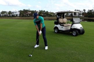 Professional Golfer Rory McIlRoy Lining Up A Shot