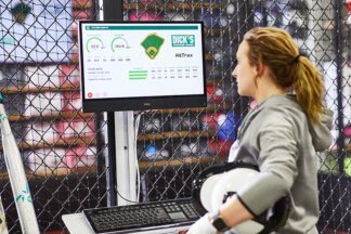 "Pro softball player Amanda ""Chiddy"" Chidester using HitTrax at DICK'S Sporting Goods"