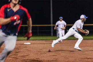 Baseball Player Fielding Ball