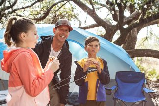 Dad and kids camping with their Quest Switchback 8 Person Cross Vent Dome Tent