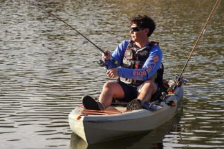 Person Fishing In Fishing Kayak On Water