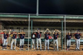 baseball players pay attention to the baseball game in the dugout of a baseball field