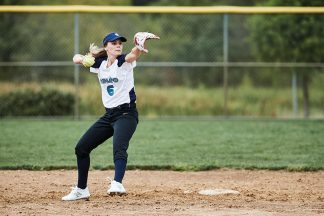 Softball Player Throwing Softball