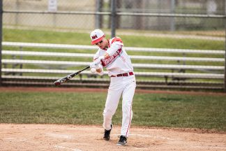 Baseball Player Swinging Bat