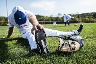 Baseball Player Stretching On Field