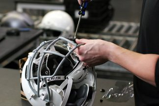Visor Being Installed On Football Helmet