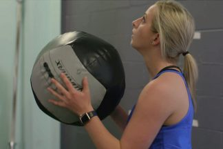Female Athlete Holding Medicine Ball