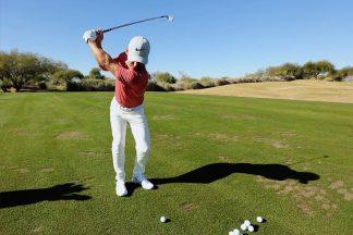 Professional Golfer Paul Casey Swinging An 8-Iron