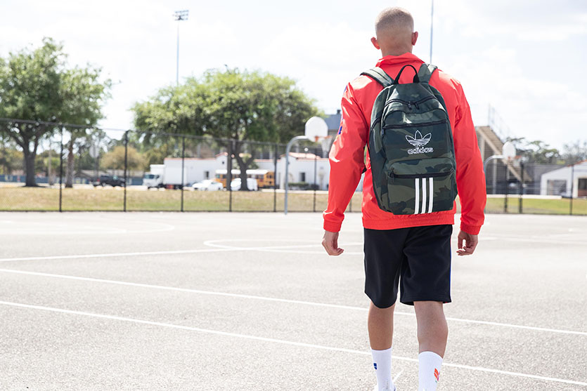 Male Student Wearing adidas Backpack While Walking To School