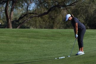 Professional Golfer Cheyenne Woods Chipping On Golf Course