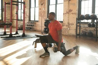 Man performing a lunge in a gym