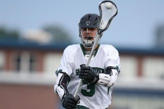 A man playing lacrosse.
