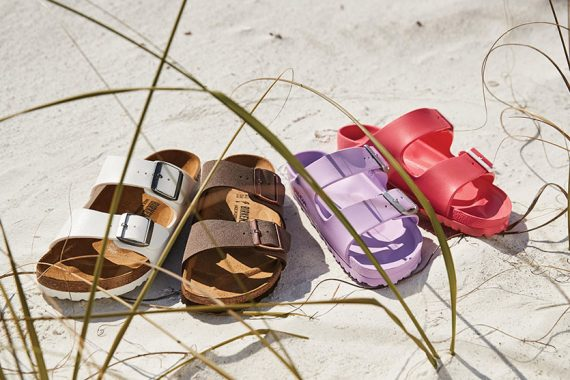 A Collection Of Birkenstock Women's Sandals In Various Colors