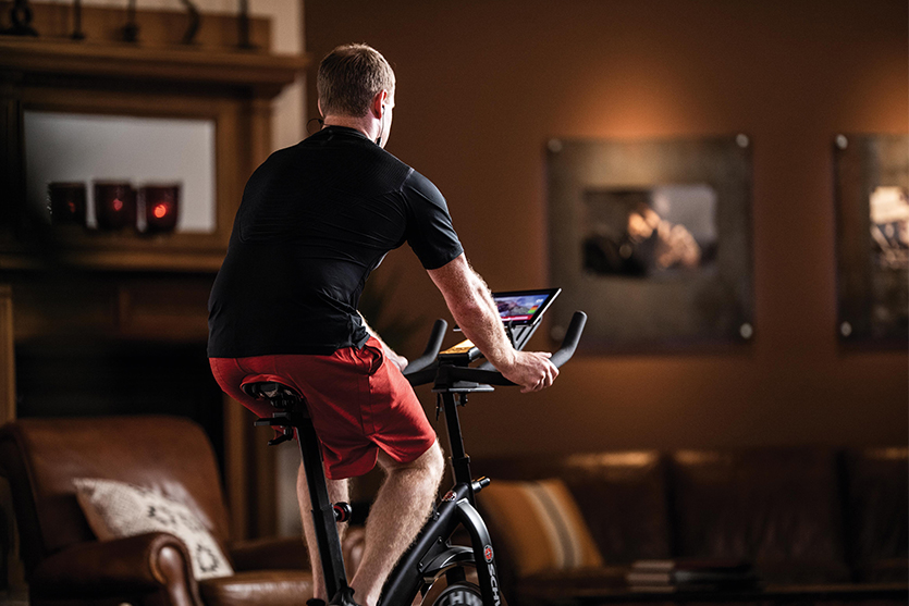 Man Riding Exercise Bike At Home