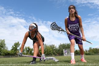 Two women lacrosse players