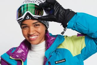 female snowboarder wearing Columbia snow jacket and snow goggles