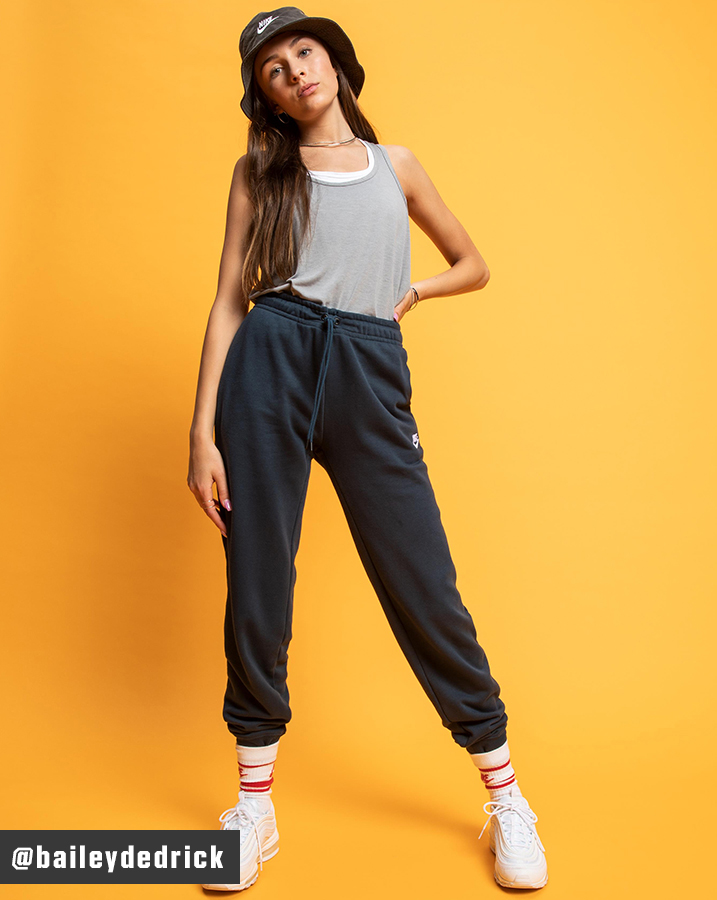 Bailey Dedrick wearing Nike Yoga Layer Tank Top and Sportswear Essential Fleece Jogger Pants, The Nike Sportswear Bucket Hat and the Air Max 97 Shoes