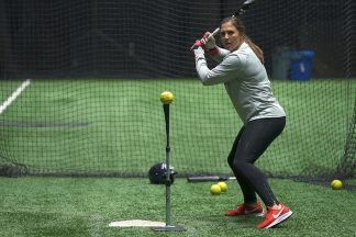 amanda chiddy chidester hitting softballs off a batting tee