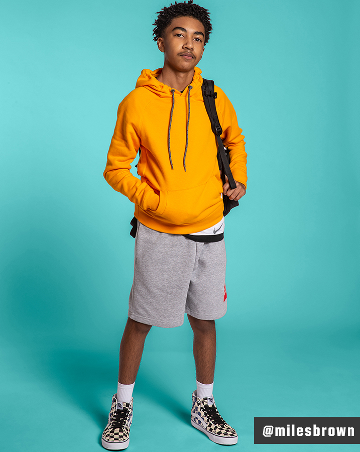 Miles Brown wearing Vans SK8-Hi Big Check Canvas Shoes, The North Face Never Stop Shorts and DSG Cotton Fleece Hoodie.