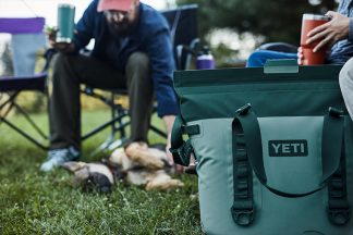 camping in a field with a yeti cooler