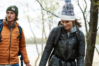 man and woman hiking and wearing Patagonia jackets